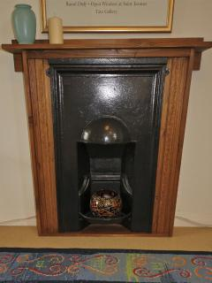 This is purely decorative, but has been restored and is in keeping with the original fittings