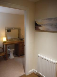 Cottage is deceptively spacious: this is the view into the bedroom from the entrance hall