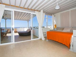 Ocean View Penthouse Curtained Double Day Bed in Lounge with view