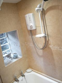 first floor bathroom with electric shower