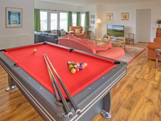 Big lounge with pool table and ping pong.