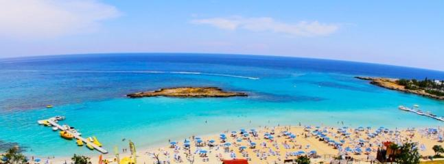 Fig Tree Bay (many water sports available/restaurants & snack bars)