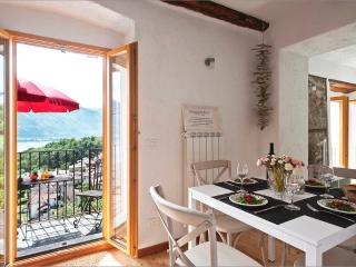 The stunning property comprises a spacious and bright living room with rustico character features