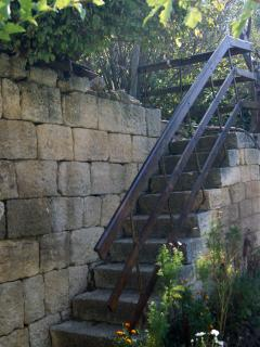 Stairs to the gardens with vegetables, fruits and places to relax with hammocks