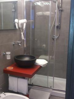The first de luxe bathroom with two-seat shower, and 'bidet'.