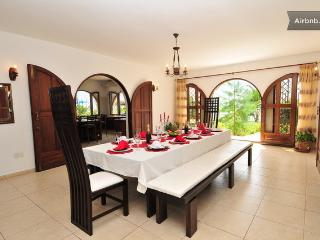 Spacious dinning room with straight access to the ocean front.
