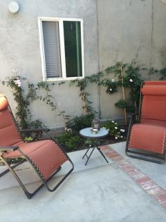 2 lounge chairs outside unit