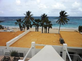 CORAL BEACH CLUB... 2 & 3 BR beach view villas just steps from beautiful