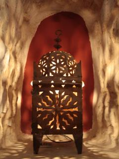 Romantic Moroccan lighting in a stone niche in the dining room.