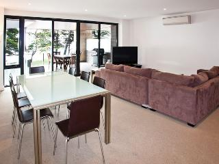 spacious living and dinning table to seat 8 people with sea views