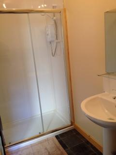 Modern roomy double shower enclosure & Triton power shower