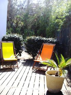 Large sunny wooden terrace to relax on the sun loungers, quiet