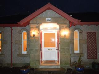 Welcome to Arran Lodge - entrance at night.