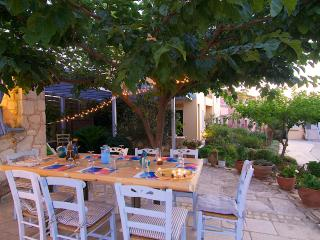 Outdoor dining area by the pool, we also have vegetable and herb garden!
