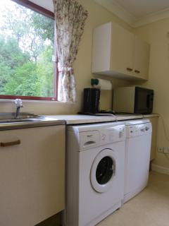 Kitchen showing washing machine and dishwasher