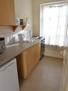 Galley style kitchen, complete with washing machine, microwave and cooking facilities.