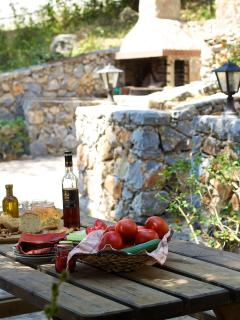 Outdoor dining area under the trees, enjoy your open-air meal!