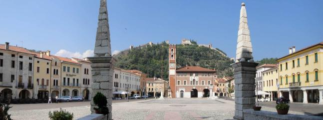 Marostica, 2 beautiful castles united by a Medieval wall hosts a human chess game. 20 mins away