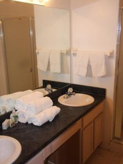 En-suite bathroom with double sinks