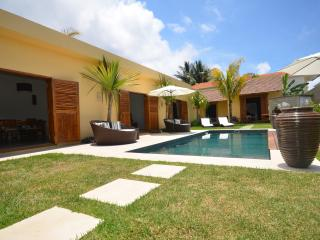 Pool with at the back two twin bedrooms