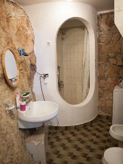 Bathroom (lower floor), encaved in rock