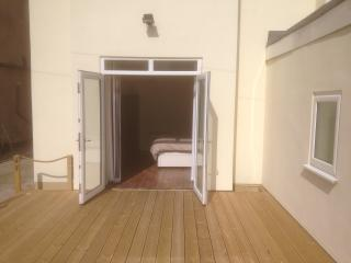 main bedroom leading onto decking