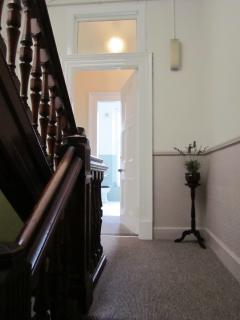 Victorian Staircase which leads up to apartment