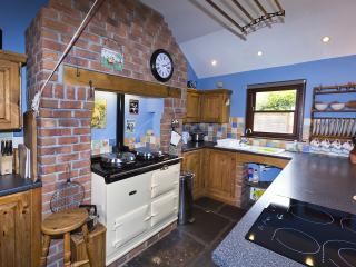Beautiful well equipped country kitchen with all you need for a perfect holiday and Aga available.