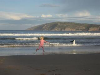 Kids playing on Robberg beach (in front of cottage)