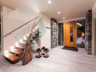 Entry Foyer and Stair to Recreation Room and Loft Bedroom c/w ensuite and walk-in rain fall shower.