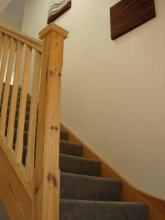 Take the stairs to two more bedrooms