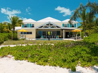 This 4,000 sq. ft luxury vacation villa is situated directly on Turks & Caicos' beautiful white sand beach of Grace Bay