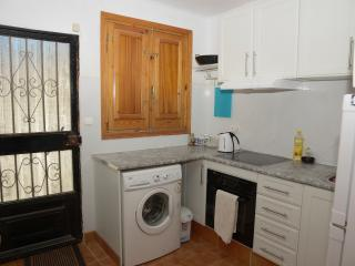 Fully equipped kitchen/Front door.