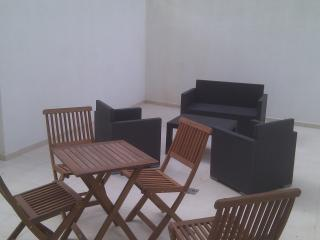 Wide terrace with lounge and table