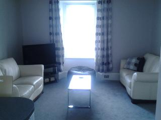 Sitting room with comfy sofas, a bean bag and a nice big TV, dvd, books and unlimited broadband.