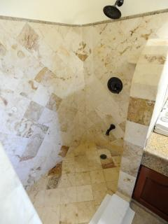 One of marble tiled en suite bathrooms