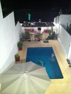 Pool area and BBQ at night