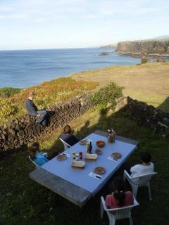 Table at bottom of garden overlooking the Ocean