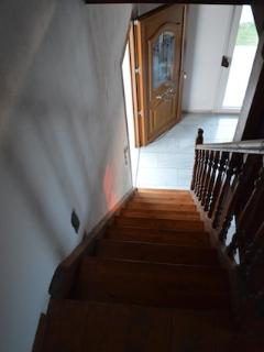 Staircase leading down / main entrance