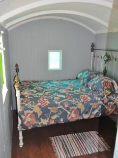 Enjoy the vintage brass bed in the private double bedroom.