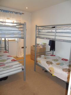 Bunk room with 2 sets of bunk beds.