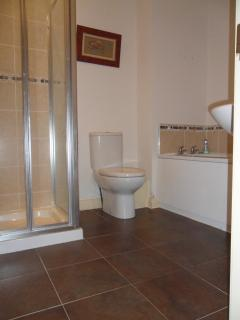 Bathroom with bath and separate shower cubicle.