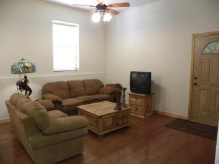 Comfortable living area just off the kitchen in an open layout.