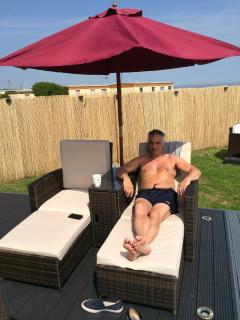 Guest enjoying twin sun lounger 124