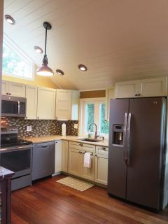 The glass tile back splash, bronze fixtures, and bamboo handscraped flooring can all be viewed here.