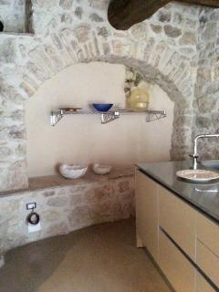 This niche in the tower wall serves as a sideboard in the kitchen area