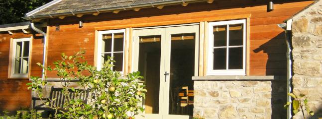 rebuilt back of cottage overlooks productive walled garden