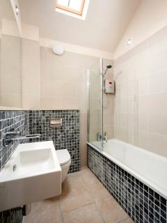 3 luxury ensuite bathrooms, 1 with bath and overhead shower, 2 with showers