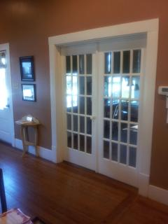 Antique french doors lead into your master bedroom