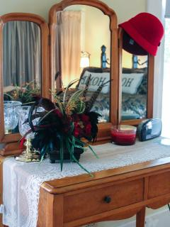 Antique dressing table in master bedroom, a great place to hang your hat